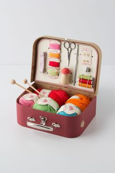 INSPIRATION :: Cute idea for a sewing kit...you could use a tin lunch pail or even a cigar box. I like how there's elastic bands to hold the tools in place.