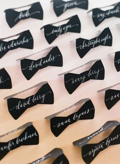 Black Bow-Tie-Shaped Escort Cards | Kristen Henderson Calligraphy | Best Day Ever Studios https://www.theknot.com/marketplace/best-day-ever-studios-charlotte-nc-610378 | Corbin Gurkin Photography https://www.theknot.com/marketplace/corbin-gurkin-photography-charleston-sc-767241