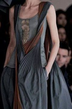Great way to alter a singlet - I would wear something under it though! Or maybe add a silk panel for modesty? Also love the twisted and pleated shawl thingy ...