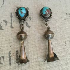 """Native American turquoise dangle earrings This vintage pair has not been polished. It is 2"""" in length. There are no hallmark stamps. Beautiful turquoise and brown colors on the stone. Native American Jewelry Earrings"""