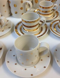 Brand new hand thrown porcelain espresso cups and saucers with spots and stripes in gorgeous gold lustre £30 from info@lunalighting.co.uk