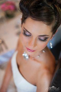 Wedding makeup in rose, brown and black, with false eyelashes and black eyeliner