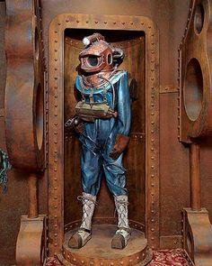 Jules Verne dive suit, Home Theater Design Jules Verne dive suit, Home Theater Design – Heimkino Systemdienste Jules Verne, Steampunk Interior, Steampunk House, Diving Helmet, Diving Suit, Nautilus Submarine, Deep Sea Diver, Sea Diving, Leagues Under The Sea