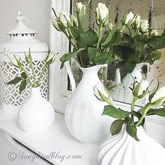 Another view:  White mantel decor with roses in front of a vintage French mirror. Via Songbirdblog.