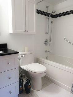 Bathroom Showrooms Toronto bathroom with a dark, custom made vanity and bright, beautiful