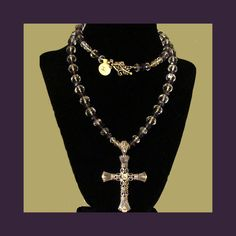 """This is my 30 inch """"Italian Renaissance Cross"""" necklace. I'm not sure it IS Italian Renaissance in style, but it FEELS like it is. The strand is 8mm Clear Faceted Chinese Crystal Roundels and 6mm Transparent Purple Chinese Crystal Roundels, strung on sterling silver chain. It is finished with a decorative Hook clasp. $36 Free Shipping.  Earrings and/or bracelet available for additional cost."""