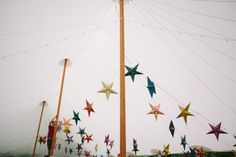 a ceiling filled with star lanterns... tented wedding reception