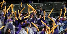 Soggy New York University students gave themselves a big cheer during a rain-spattered graduation ceremony Wednesday.