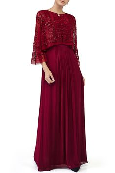 Featuring a ruby red pleated solid gown in georgette adorned with bell sleeved short cape in net accented with dori and sequin work. Fabric: Georgette, Net Care Instructions: Dryclean only.