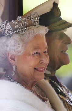 Queen Elizabeth with her husband the Duke of Edinburgh leaving for the State Opening of Parliament in London (May, 2015)