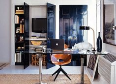 Nate Berkus used one of the closets for a media center & home office & painted the closet doors with High Gloss Black Paint + the glass table can be used as a desk or dining table. Painted Interior Doors, Black Interior Doors, Interior Paint, Interior And Exterior, Interior Design, Painted Doors, Gray Interior, Nate Berkus, Dark Doors