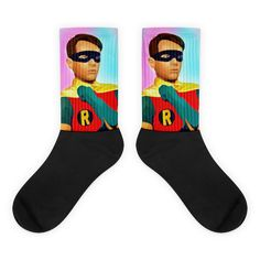These socks are extra comfortable thanks to their cushioned bottom. The foot is black with artwork printed along the leg with crisp, bold colors that won't fade. Cool Socks, Awesome Socks, Batman Robin, Hanging Dryer, Us Man, Artwork Prints, Bold Colors, Legs, Cotton