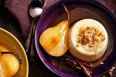 Creme fraiche panna cotta with cinnamon-poached pears and praline. Delicious Magazine Australia