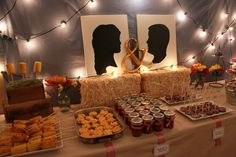 Corn on the cob, brown paper table cloths, gingham ribbon... jarred goodies..