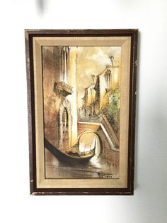 Beautiful hand painted, framed painting. Looks to be a scene in Italy.  Frame is wood with a bit of wear on edges, hanger on back. Painting is in god condition.  with frame - 11 ½ x 7 ½ inside picture - 9 ½ x 5 ½  Painting is signed by the artist and dated 1979  It looks as thought the painting is a combination of mediums.  Would make a great addition to your Mid Century wall gallery!  _________________________________________________________________________  Etsy Shop>> https:/&#x...