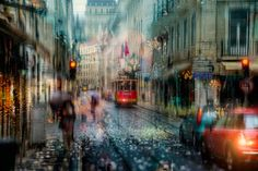 Rain-soaked street photographs that look like impressionist oil paintings | Creative Boom