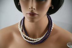Ivory and dark purple 4 strand necklace.  this can by bazinedezine, $33.00
