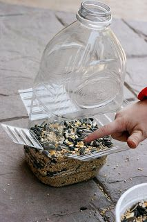 Another plastic bottle bird feeder using a larger bottle. {from Sparklinbecks}