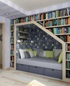 Alcove bed nook with bookcase storage