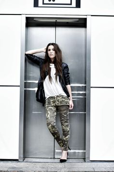 Zara camouflage pants, leather jacket, heels & top; Cooee necklace; Tiger by Sweden bag