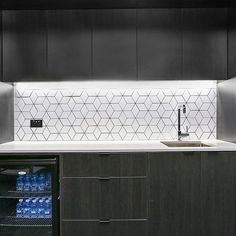 This concealed kitchen is such a smart piece of joinery and we absolutely adore the texture created by this splashback. A really clever use of design in such a small space. #pinnacleplus #designthinking #design #property #underthehammer #kitchen #concealedkitchen #design #interiordesign #concealedkitchen #smallkitchen #kitchendesign #architect