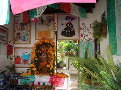 altar and papel picado and embroidery for dia de los muertos in valle de bravo, mexico