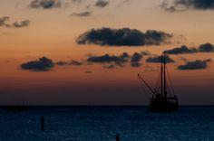 A sailboat at sunset on the island of Aruba