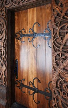 Norwegian Carved Entry Portal - (Brian H. Brothers; architect) see more at brianhbrothers.com