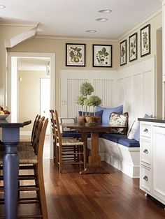 I like that the board & batten is framing bead board paneling.  I also like how it doesn't cever the whole wall.  Love the wide moldings.