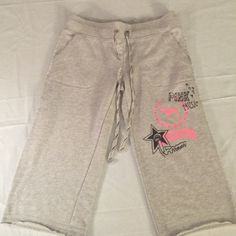 PINK by VICTORIA SECRET Cropped Sweatpant 🎼 PINK by VICTORIA SECRET Cropped Sweatpant size Adult X-small. Adorable MUSIC THEME! Pink and Black Rhinestones on front and back. PINK Victoria's Secret Pants