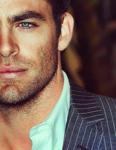 Blue eyes. Brown hair.