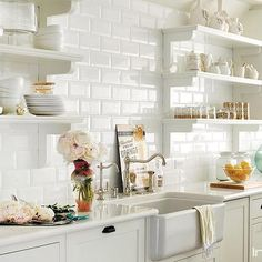 Domino shares editors' favorite celebrity kitchens from across the country to inspire kitchen design ideas in your own home. See the best celebrity kitchens belonging to Chrissy Teigen, Julia Roberts, Diane Keaton, and more. All White Kitchen, New Kitchen, Kitchen Dining, Kitchen Decor, Kitchen Cabinets, Kitchen Ideas, Kitchen Shelves, White Cabinets, Open Cabinets