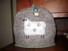 http://sheepyhollow.files.wordpress.com/2010/01/sheep-tea-cozy1.jpg
