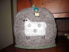 http://sheepyhollow.files.wordpress.com/2010/01/sheep-tea-cozy1.jpg