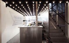 Paris New York  CUT Architects 2012 The black awning and interior ceiling are pierced by a grid of light bulbs reminiscent of the Broadway cinema