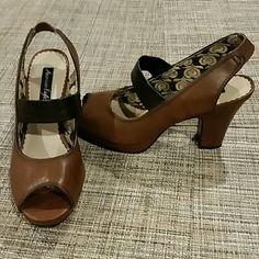 """Boutique shoes American Eagle peep toe heels. Worn maybe twice. Camel color, thick heel and small platform that makes them comfortable. Heel 3 3/4"""", platform 1/2"""" Beautiful pair of shoes ***Sorry, I don't model, this are my sis shoes  ***CONSIDERING ALL OFFERS*** American  Eagle Shoes"""