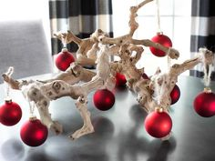 Manzanita Branch Tree - Coastal-Inspired Holiday Decorating Idea.  You can also use rope-strung shells, sand dollars and starfish as makeshift ornaments to adorn each branch.