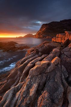~~Sleepy Bay Sunrise ~ an early morning glow illuminates the orange tessellated granite at Sleepy Bay, Freycinet National Park, Tasmania, Australia by Nick Skinner~~