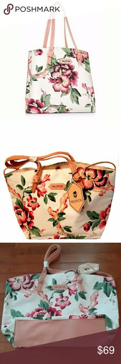 """Wildfox Limited Edition Floral Tote This brand new tote bag is perfect for your beach, pool, or travel essentials. Light pink lining. Cute faux leather trim. No pockets. Magnetic snap closure. Material: polyester/PVC. Approximate measurements: 18""""l x 13""""h x 4.5""""w with 9.5"""" strap drop. Gift with purchase. Super trendy! Wildfox Bags"""