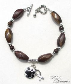 Pet Adoption Awareness: Brown Ceramic and Sterling Silver Plated Bracelet, 8.50 inches.  30% of your purchase price goes directly to the Chester County Pennsylvania SPCA!  Serving my community since 1929, the Chester County Society for the Prevention of Cruelty to Animals is an award-winning shelter for homeless and abused animals.