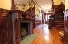 """Entrance hall with fireplace, Newburgh, NY,  Home built for Lewis Smith. Smith was one of Newburgh's wealthiest citizens in the late 1800's and he hired renowned architect Frank Estabrook to create a home that demonstrated that fact. Estabrook homes were known for their fortress-like construction quality and for their high level of detail and craftsmanship."""""""