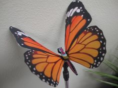 """36' Garden LED Stake Orande Butterfly by Domani. $13.50. Stainless steel stake. H 35"""" W 5"""" D 5"""". Fiber optic and LED lighting Solar powered. Looks great in light or dark. Ships """"ready to use"""". This orange butterfly garden stake decoration contains an amazing show of color changing LED and fiber-optic lighting powered by a battery pack that is recharged by a solar cell. You never have to replace the batteries or plug it in to charge. Looks great in the daytime and at..."""