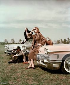 Model leaning on pink 1958 Cadillac wearing mink coat over dress by Trigere, and burgundy shoes, with another 1958 Cadillac Eldorado Biarritz convertible in the background with model Anne Saint-Marie, in black fur coat and in the front a man is seated on the ground looking through binoculars. Vintage Mode, Moda Vintage, Vintage Fur, Vintage Glamour, Vintage Photos, Retro Vintage, Classic Chevy Trucks, Classic Cars, 1950s Fashion