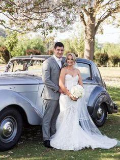 Bride wears Steven Khalil fitted lace gown with train from David Jones Bridal #weddings #weddingdress #bride #groom #bridalgown