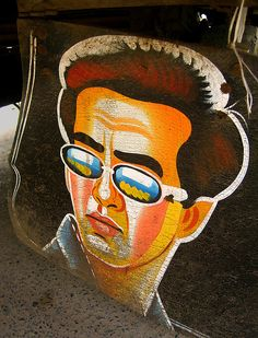 Sunny Deol in Kochrab.  A man's man!!!  Part of a collectionof images of painted mud-flaps of rickshaws & cycle carts in Ahmedabad, Gujarat, India.  Photo: Meanest Indian