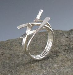 Sterling Silver Sticks Ring For this ring, I textured three pieces of sterling silver wire with a hammer, flattened the ends, soldered them together, and wove the ends together to create a beautiful, organic ring. The ring coordinates well with my large Botanical Pendant,