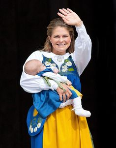 Royal wave: Princess Madeleine smiles at spectators whilst three-month-old Princess Leonor...