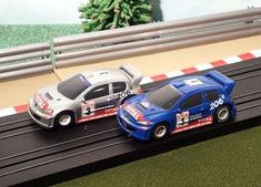 New arrival for sale! Micro Scalextric ... See it here http://www.actionslotracing.co.uk/products/micro-scalextric-pair-of-rally-cars-blue-1-silver-3-peugeot-206-wrc?utm_campaign=social_autopilot&utm_source=pin&utm_medium=pin