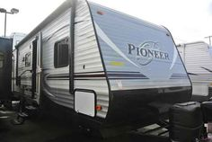 2016 New Heartland Pioneer BH270 Travel Trailer in Colorado CO.Recreational Vehicle, rv, 2016 Heartland PioneerBH270, Bike Rack, Black tank flush, Enclosed Underbelly, Night shades, Pioneer Value Package, Power Awning w/ LED Light Strip, POWER STAB JACKS, Power Tongue Jack, RVIA Seal, Spare Tire and Carrier, Winterization of Unit,