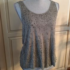 animal print tank top  Very cute print. 100% Rayon, lightweight, perfect for summer. Excellent condition, never worn. Size Juniors XL, will fit woman's medium as well. Smoke and pet free home. Mudd Tops Tank Tops
